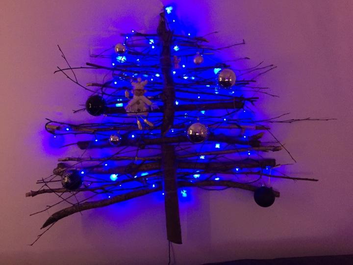 Wall mounted stick christmas tree by Stuart Moth
